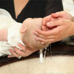 baby-baptized-godparent-water